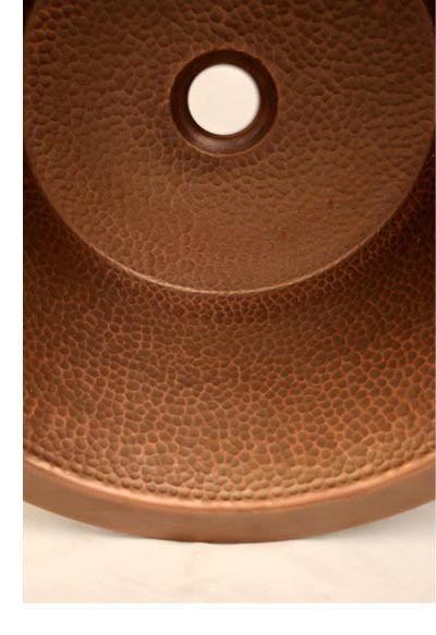 You can see the difference in the details of a hammered copper sink!