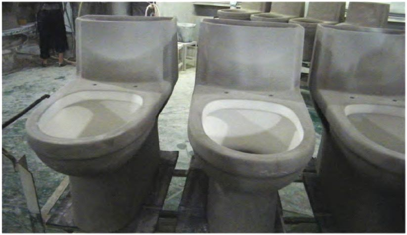 After being removed from their molds, the toilets are set to air dry.