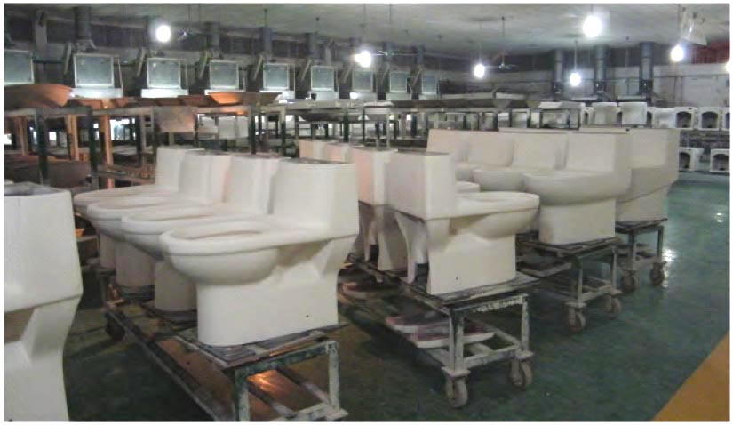 """After air drying, the toilets are taken into the kiln and fired, or """"baked"""" for the first time. With the clay becoming completely dried and solidified in the kiln, the toilets become a lighter color once removed, as shown here."""