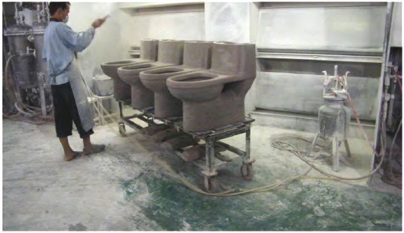 After removal from the kiln for the first time, a finishing waterproof glaze is applied by hand to ensure even coverage on each and every toilet.